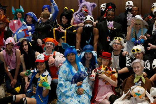 Many people dressed in their favorite Pokemon characters pose for a group picture that others were taking of them during Youmacon 2018 at Cobo Center and the Detroit Marriott at the Renaissance Center in Detroit on Saturday, Nov. 3, 2018.