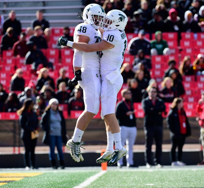 Michigan State defensive end Kenny Willekes, left celebrates with safety Matt Morrissey after sacking Maryland quarterback Kasim Hill (not pictured) during the first quarter on Saturday, Nov. 3, 2018, at Capital One Field at Maryland Stadium.