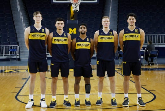 From left to right, the Michigan freshman forward Colin Castleton, guard Adrien Nunez, guard David DeJulius, forward Ignas Brazdeikis and forward Brandon Johns Jr., pose before practice, Oct. 22, 2018, in Ann Arbor.