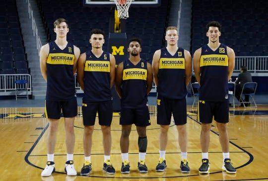 From left to right, the Michigan freshman forward Colin Castleton, guard Adrien Nunez, guard David DeJulius, forward Ignas Brazdeikis and forward Brandon Johns Jr., pose before practice, Oct. 22, 2018, in Ann Arbor.