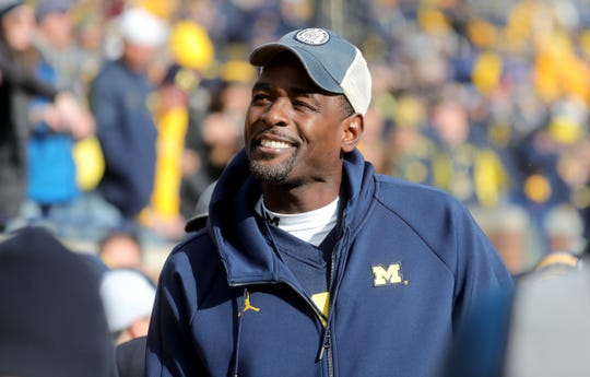 Former Michigan basketball player Chris Webber walks on the football field before the start of the Michigan and Penn State game on Saturday, Nov. 3,2018, at Michigan Stadium.