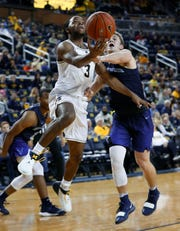 Zavier Simpson drives against Northwood's Jack Ammerman in the first half of an exhibition Friday.