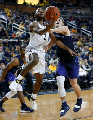 Michigan guard Zavier Simpson drives against Northwood's Jack Ammerman in the first half of an exhibition in Ann Arbor, Friday, Nov. 2, 2018.