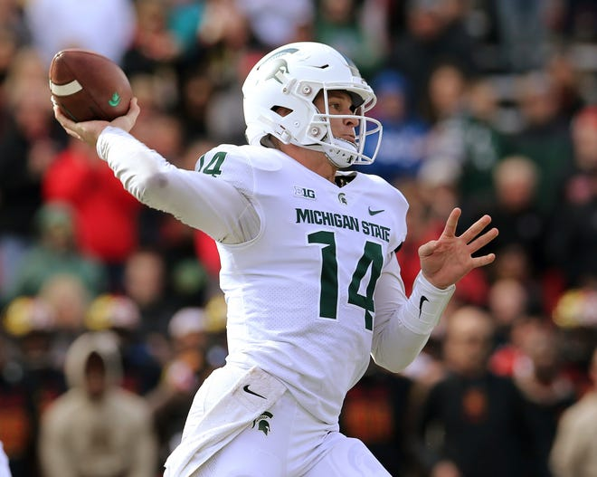 Michigan State quarterback Brian Lewerke (14) throws against the Maryland defense in the first half on Saturday, Nov. 3, 2018, in College Park, Md.