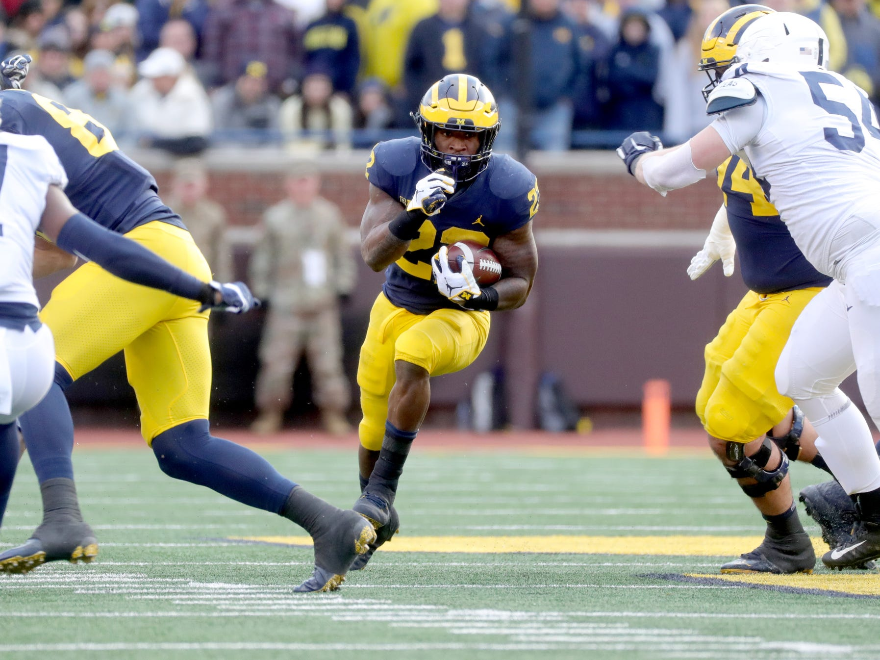 Michigan's Karan Higdon runs the ball against Penn State during the first half Saturday, November 3, 2018 at Michigan Stadium in Ann Arbor.