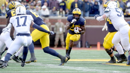 Karan Higdon runs the ball against Penn State.