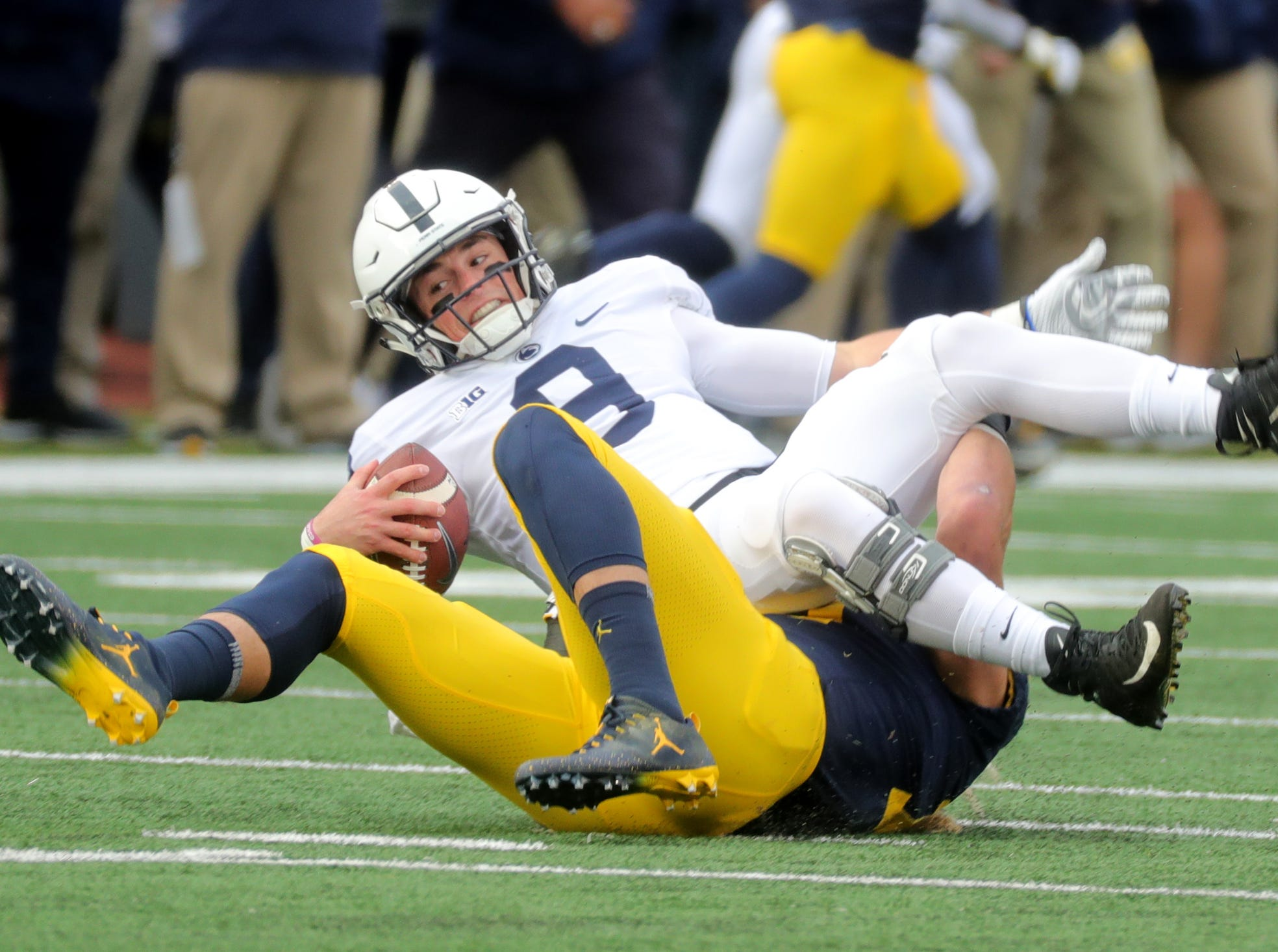 Michigan's Chase Winovich sacks Penn State quarterback Trace McSorley during the first half on Saturday, Nov. 3, 2018 at Michigan Stadium.