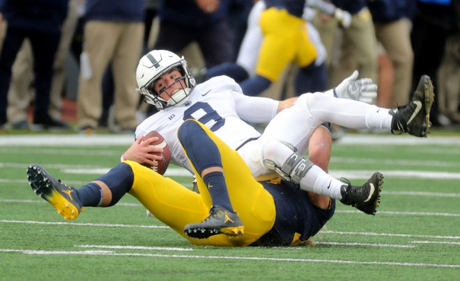 Michigan's Chase Winovich sacks Penn State quarterback Trace McSorley during the first half on Saturday, Nov. 3, 2018 at Michigan Stadium.