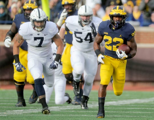 Michigan's Karan Higdon runs for yardage against Penn State during the first half on Saturday, Nov. 3, 2018 at Michigan Stadium.