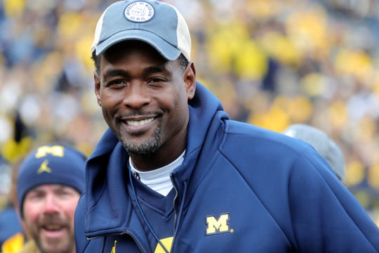 Chris Webber walks on the field prior to the start of the Michigan and Penn State game.