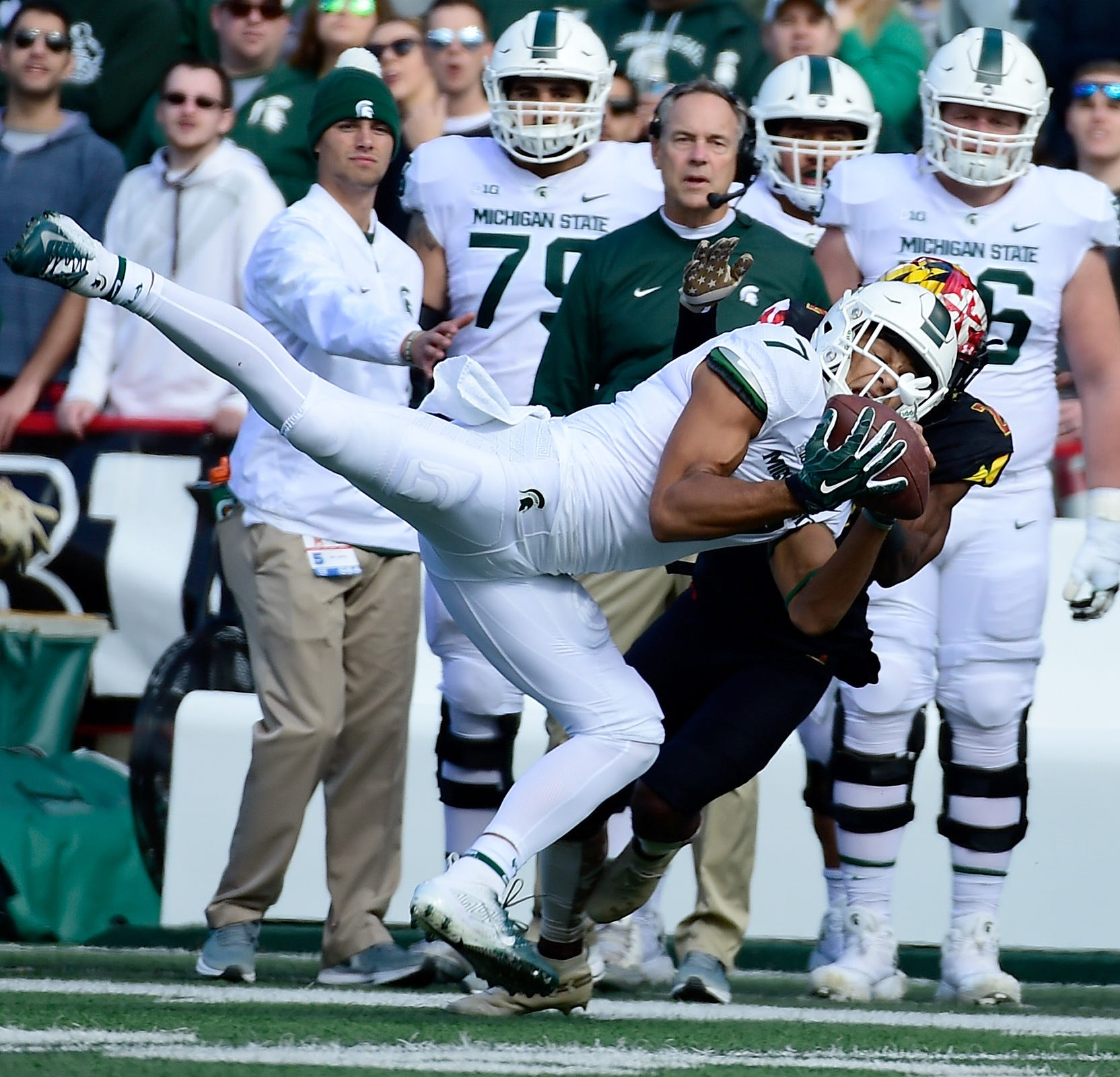 Michigan State wide receiver Cody White (7) catches a pass in front of Maryland defensive back RaVon Davis (2) during the first quarter on Saturday, Nov. 3, 2018, at Capital One Field at Maryland Stadium.