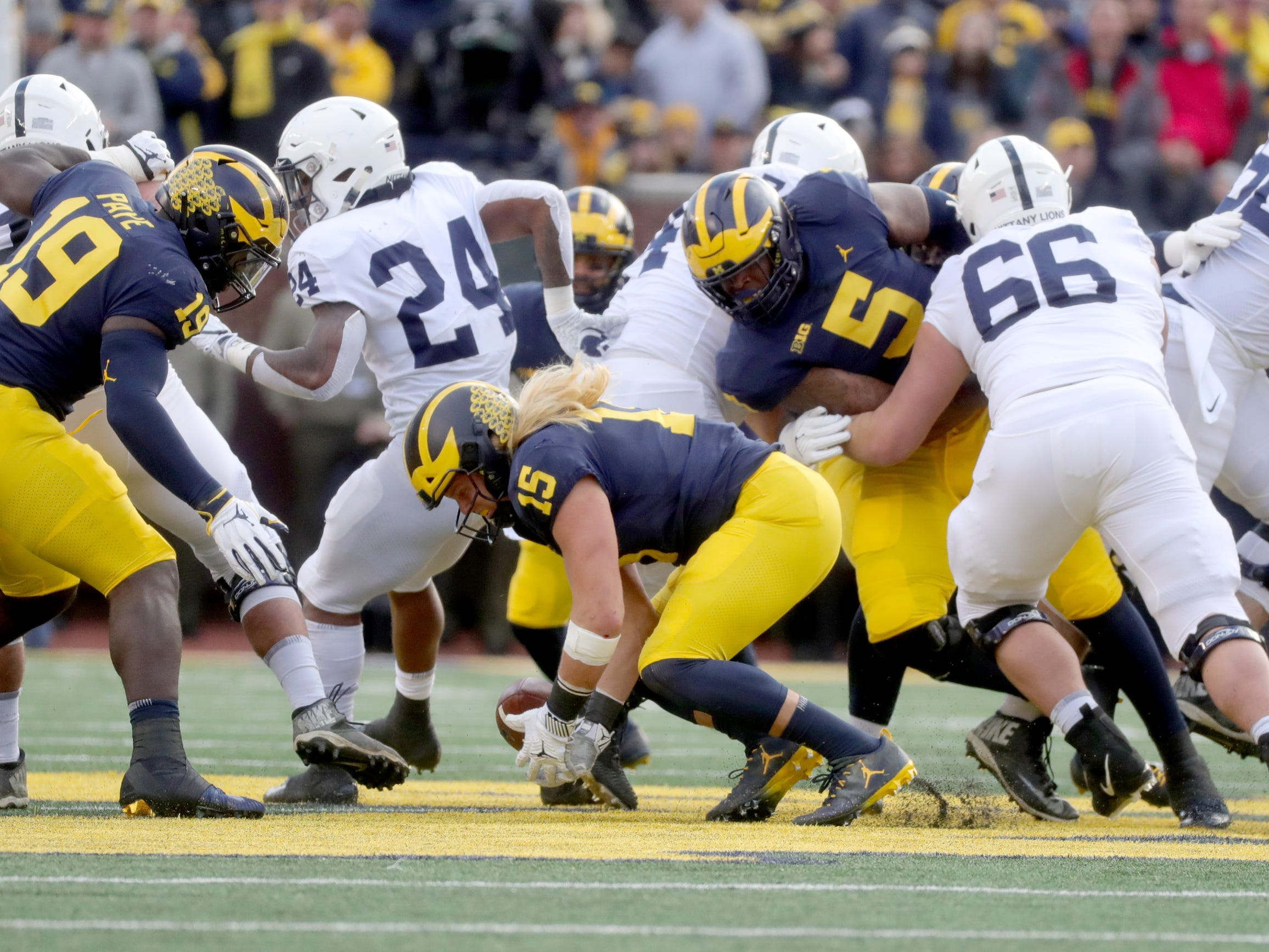 Michigan's Chase Winovich recovers a fumble against Penn State during the first half Saturday, November 3, 2018 at Michigan Stadium in Ann Arbor.