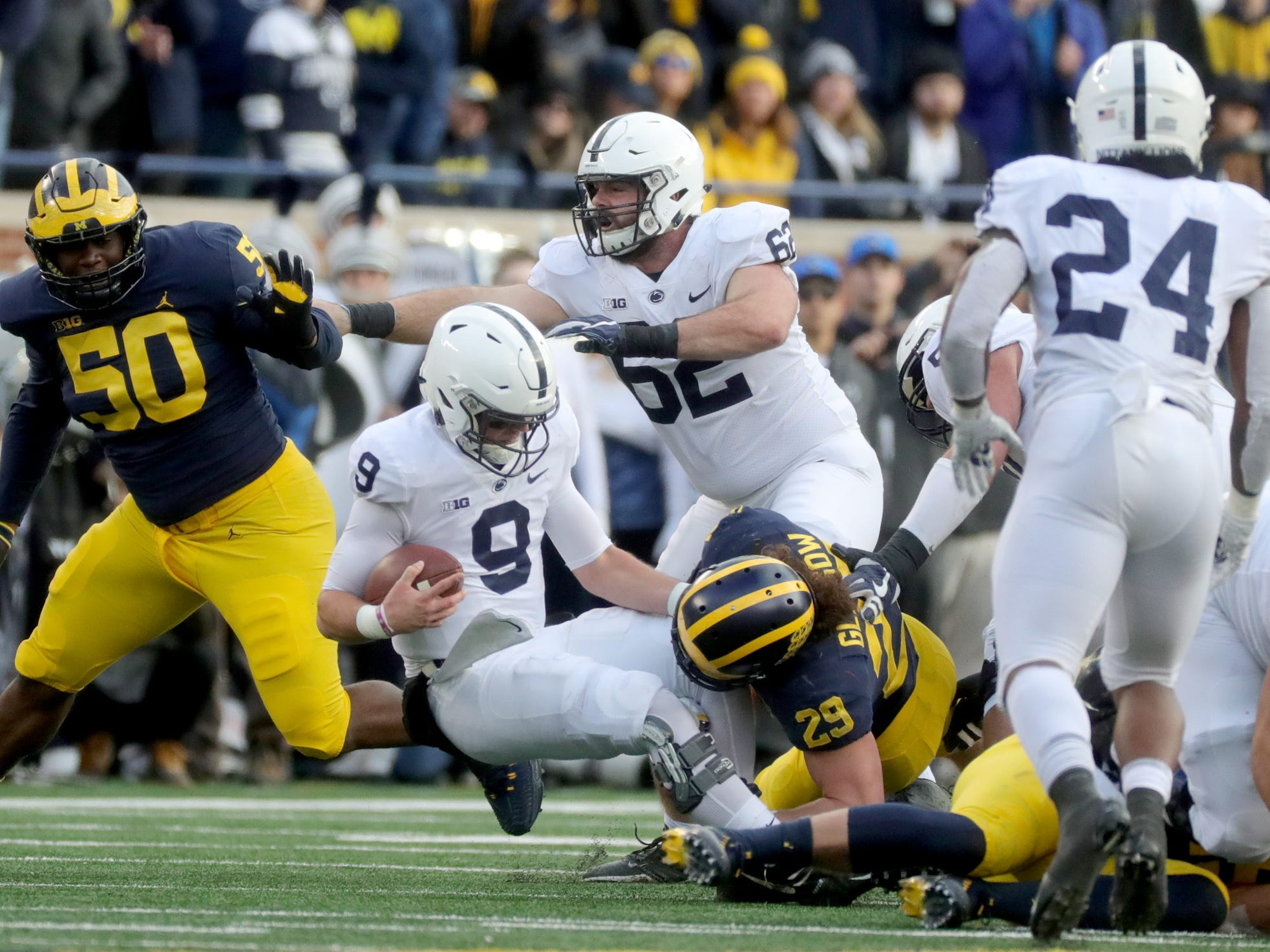 Michigan's Jordan Glasgow hits Penn State quarterback Trace McSorley during the first half Saturday, November 3, 2018 at Michigan Stadium in Ann Arbor.