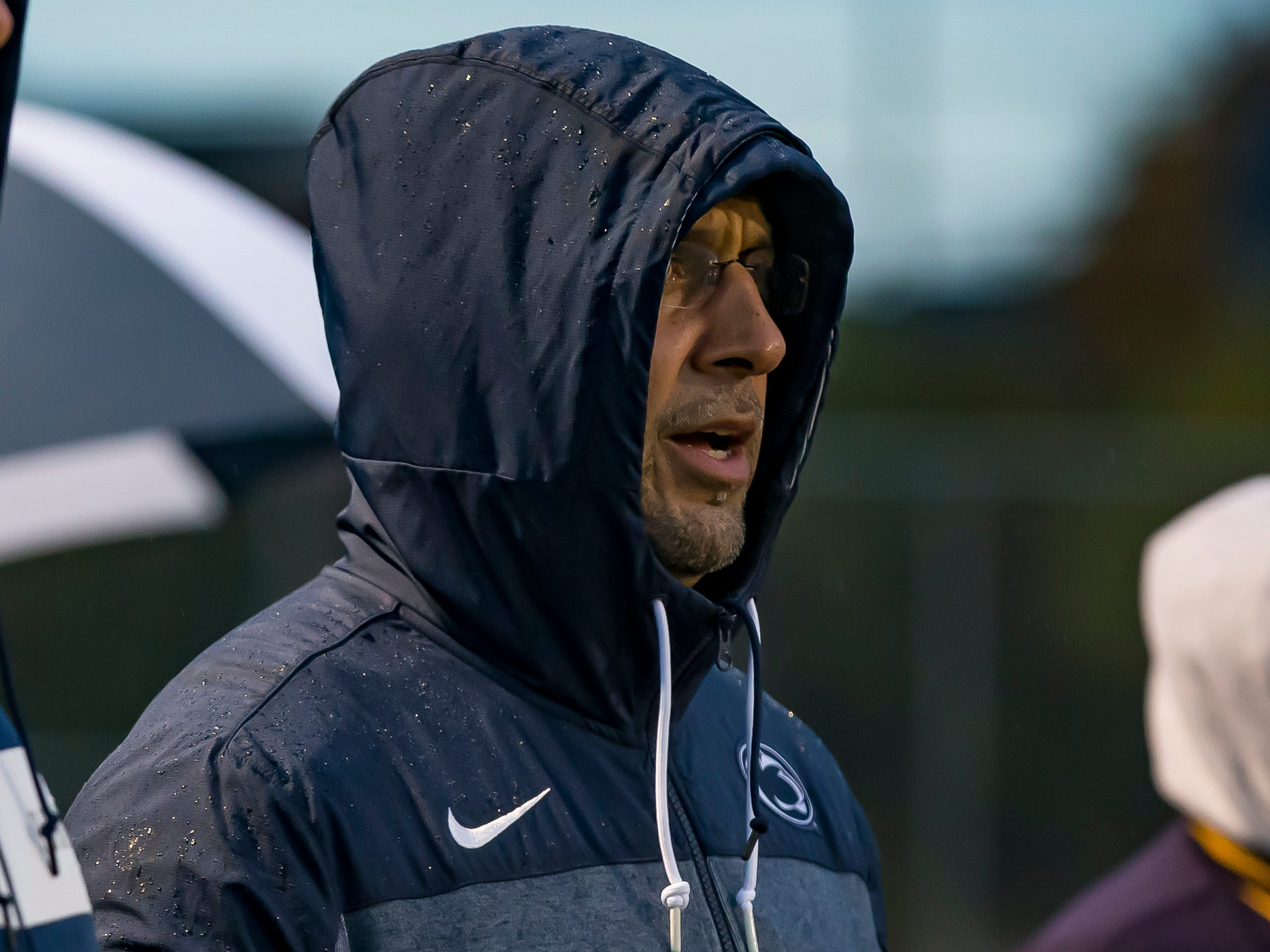 Penn State head coach James Franklin watches the game action from the side lines.