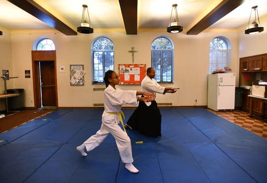 Morgan Corley, 13, trains with Larry Castleberry on the martial art of Yoshinkan Aikido in an auxiliary room at St. Marry of Redford Catholic Church.