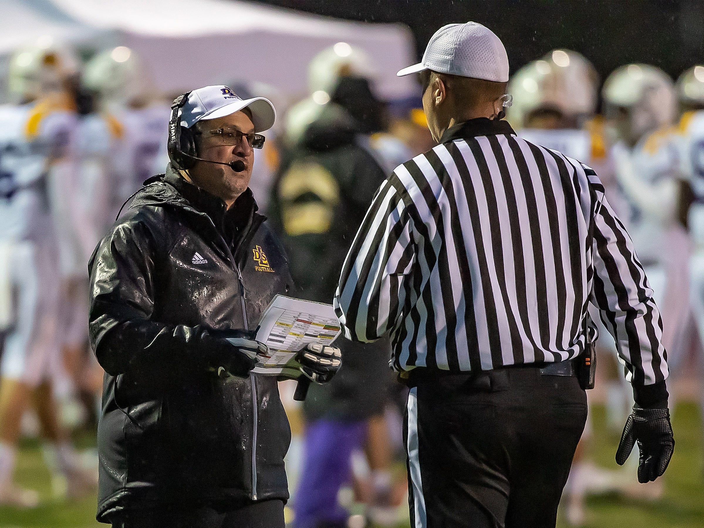 Warren De La Salle head coach Mike Giannone talks to the referee.