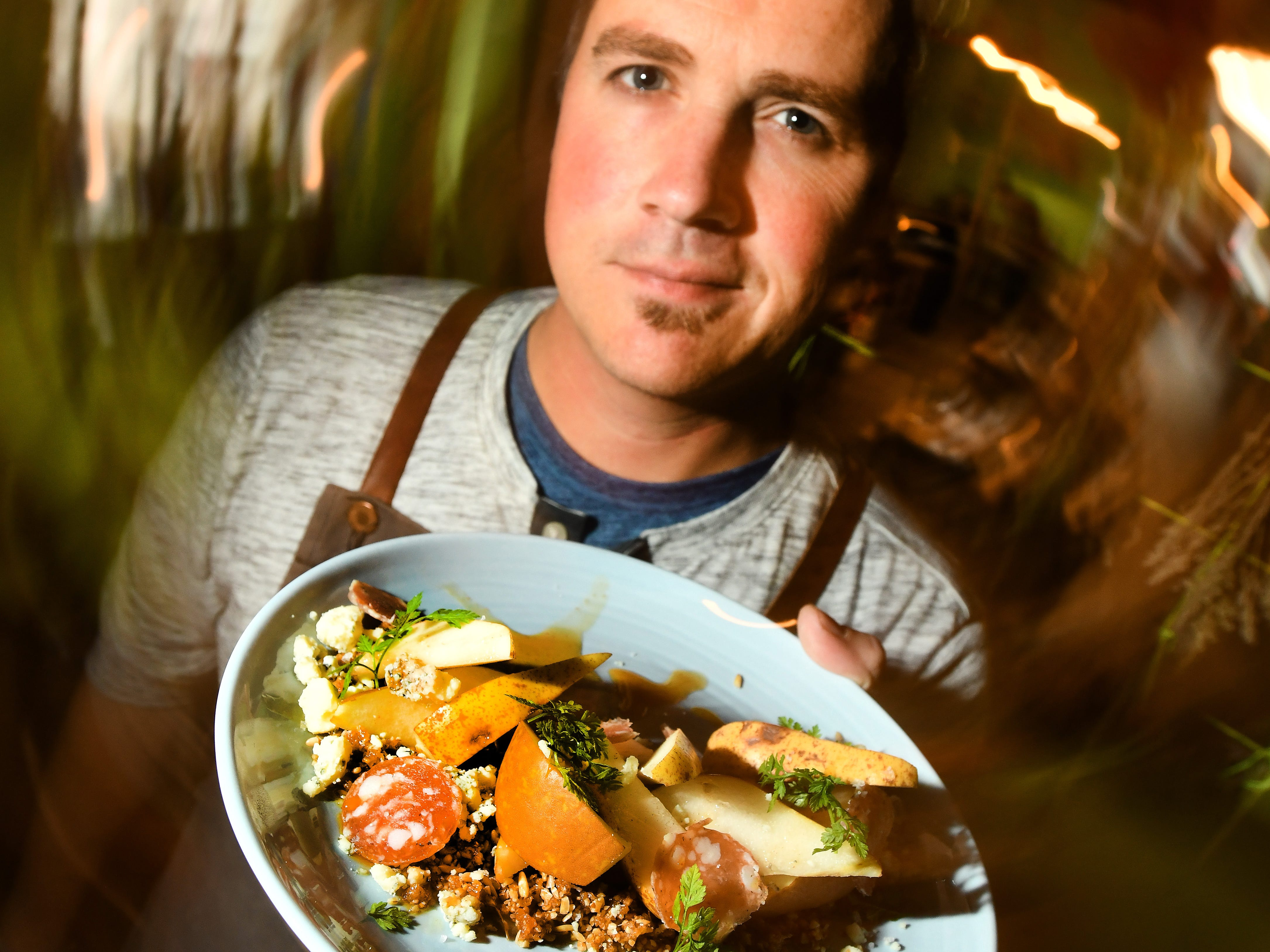 Chartreuse Kitchen & Cocktails chef Doug Hewitt jr. with Pears consisting of Bosc, Bartlett, fig and pecan granola, cider honey, cave aged blue cheese and sopressata.