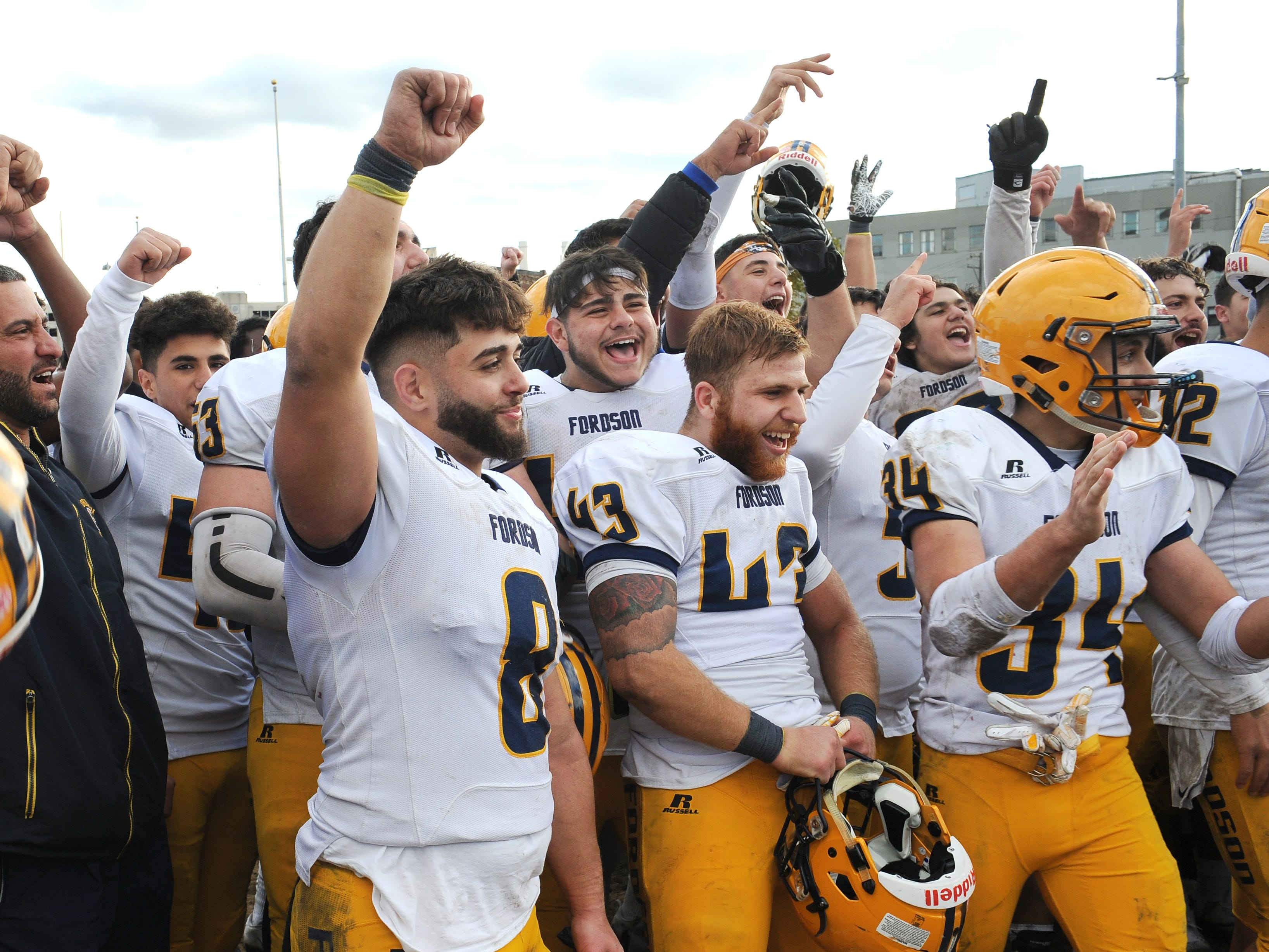 Dearborn Fordson High School players celebrate their win over Cass Technical High School 41-14.