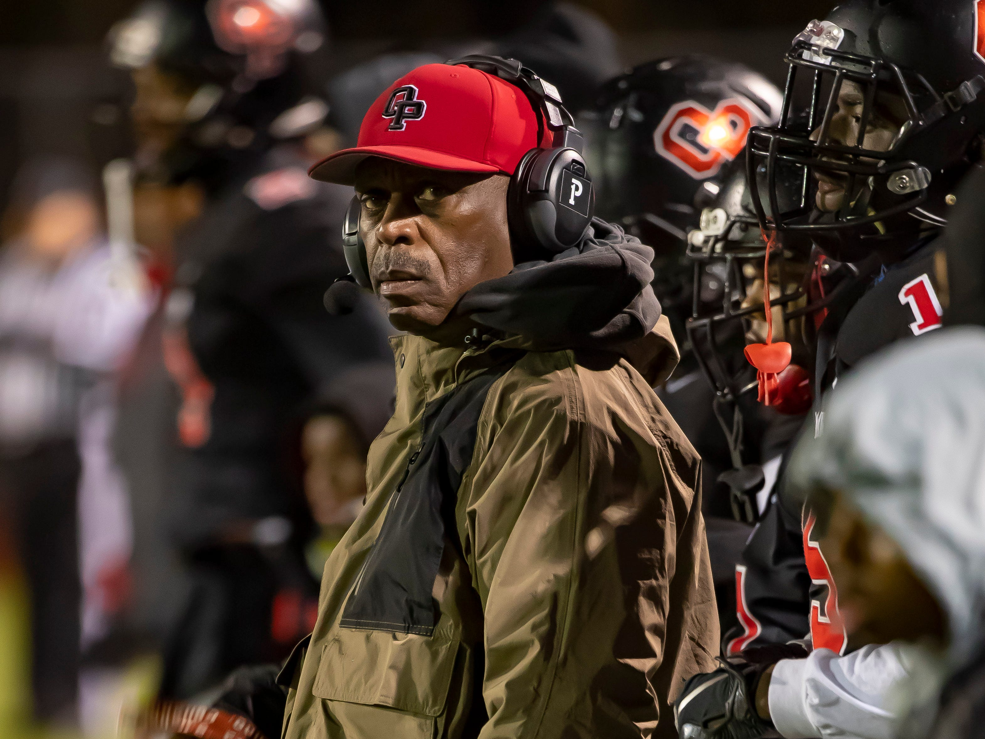 Oak Park head coach Greg Carter watches the action from the sidelines in the fourth quarter.