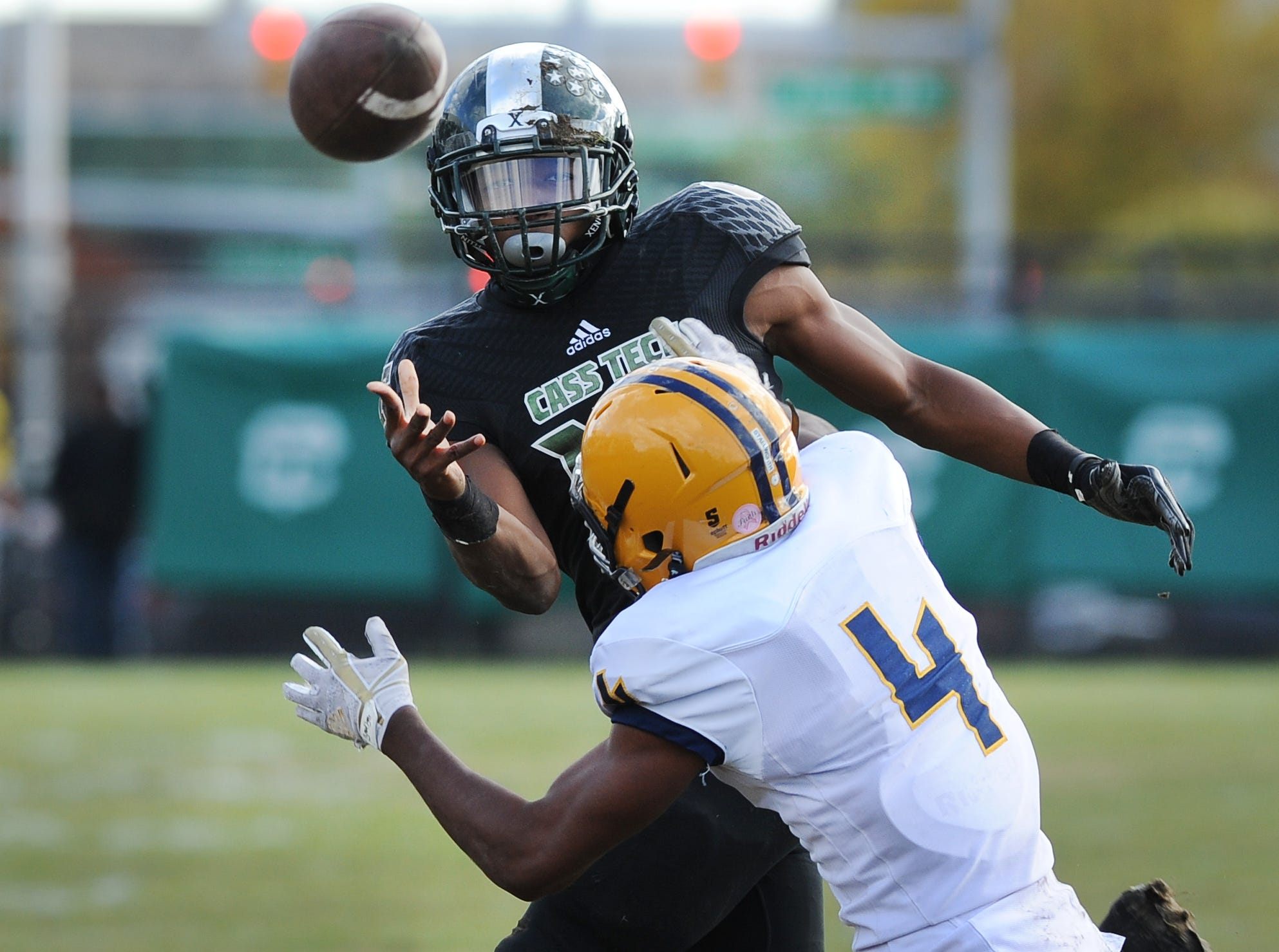 Cass Technical High School quarterback Jalen Graham (17) throws an interception in the fourth quarter against Dearborn Fordson High School in Detroit on Saturday November 3, 2018.