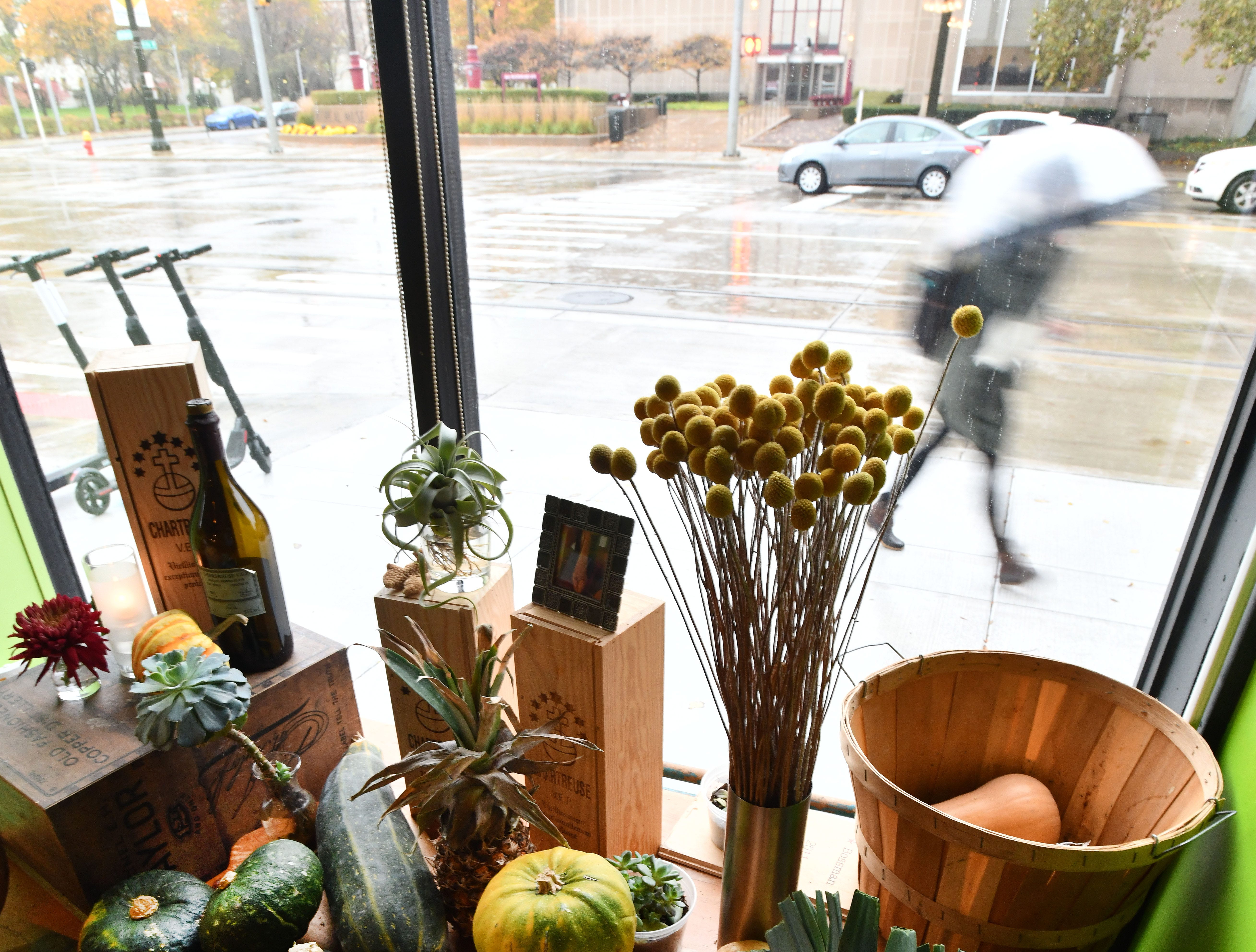 A table filled with vegetables overlooking Woodward Avenue on a rainy November afternoon.