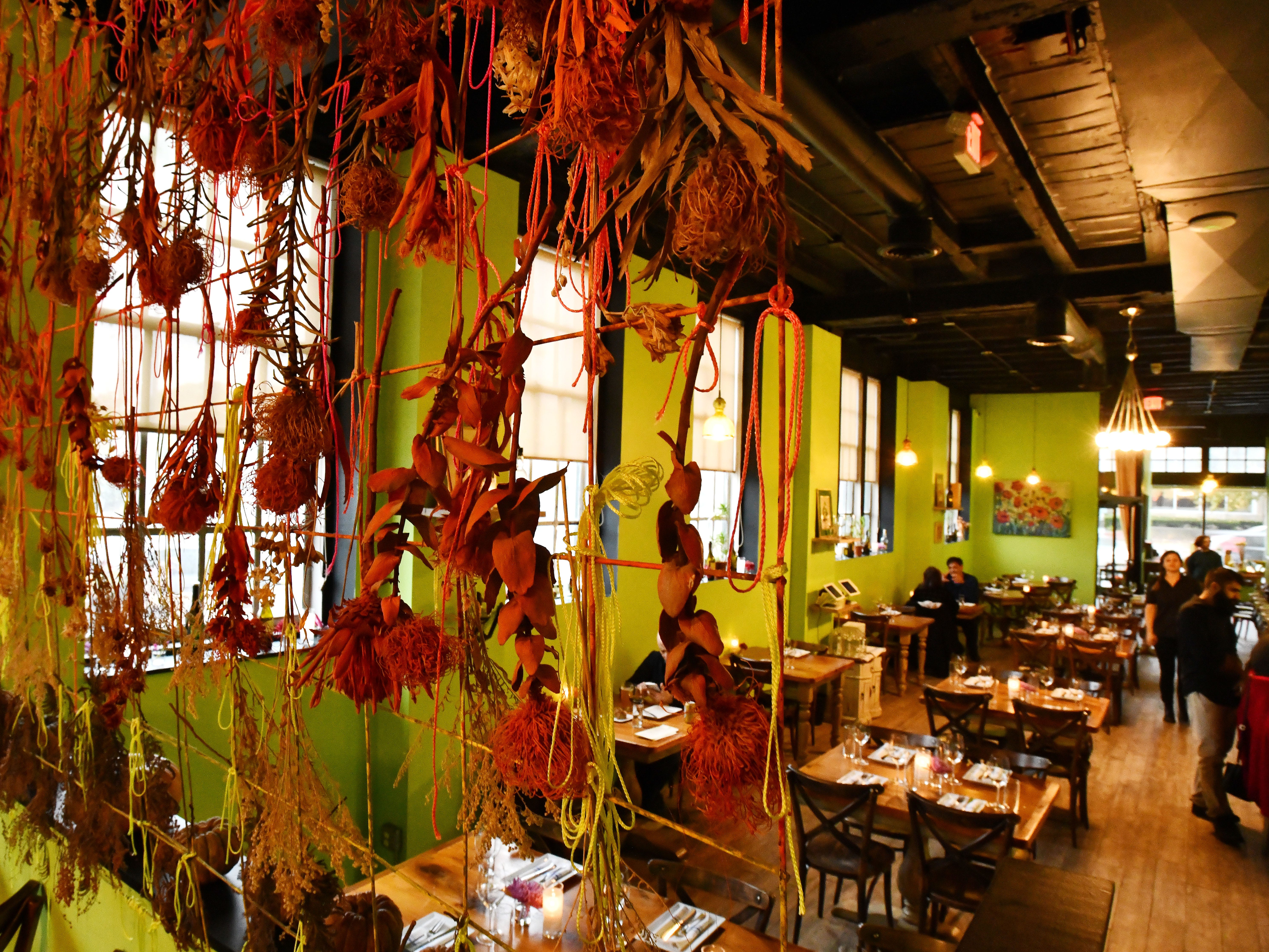 The colorful main dining area with room dividing art work.