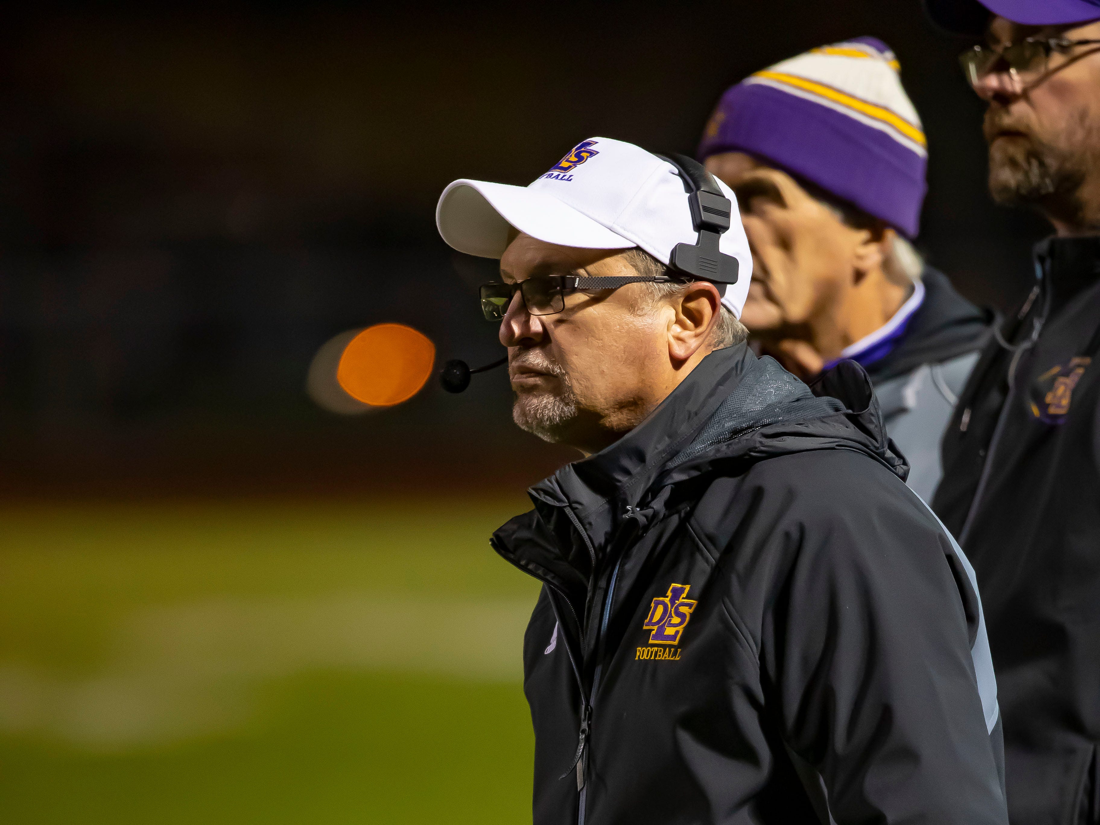 Warren De La Salle head coach Mike Ginnone watches the action from the sidelines in the fourth quarter.