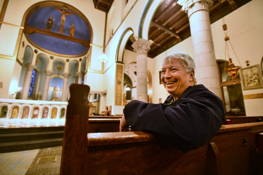 Father Charles Morris sits in St. Mary's of Redford Catholic Church.