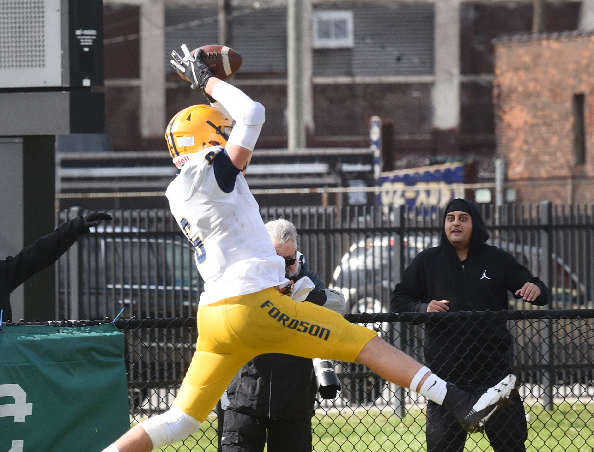Dearborn Fordson High School's Hadi Hamid (6) leaps into the end zone for a touchdown in the first quarter against Cass Technical High School in Detroit on Saturday November 3, 2018.
