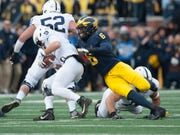 Linebacker Josh Uche is one cog in an experienced and talented front seven for Michigan this season.