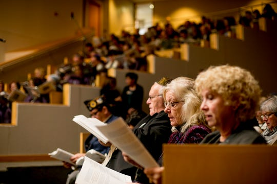Congregants pray at a Shabbat of Solidarity service at Temple Shir Shalom in West Bloomfield on Saturday.