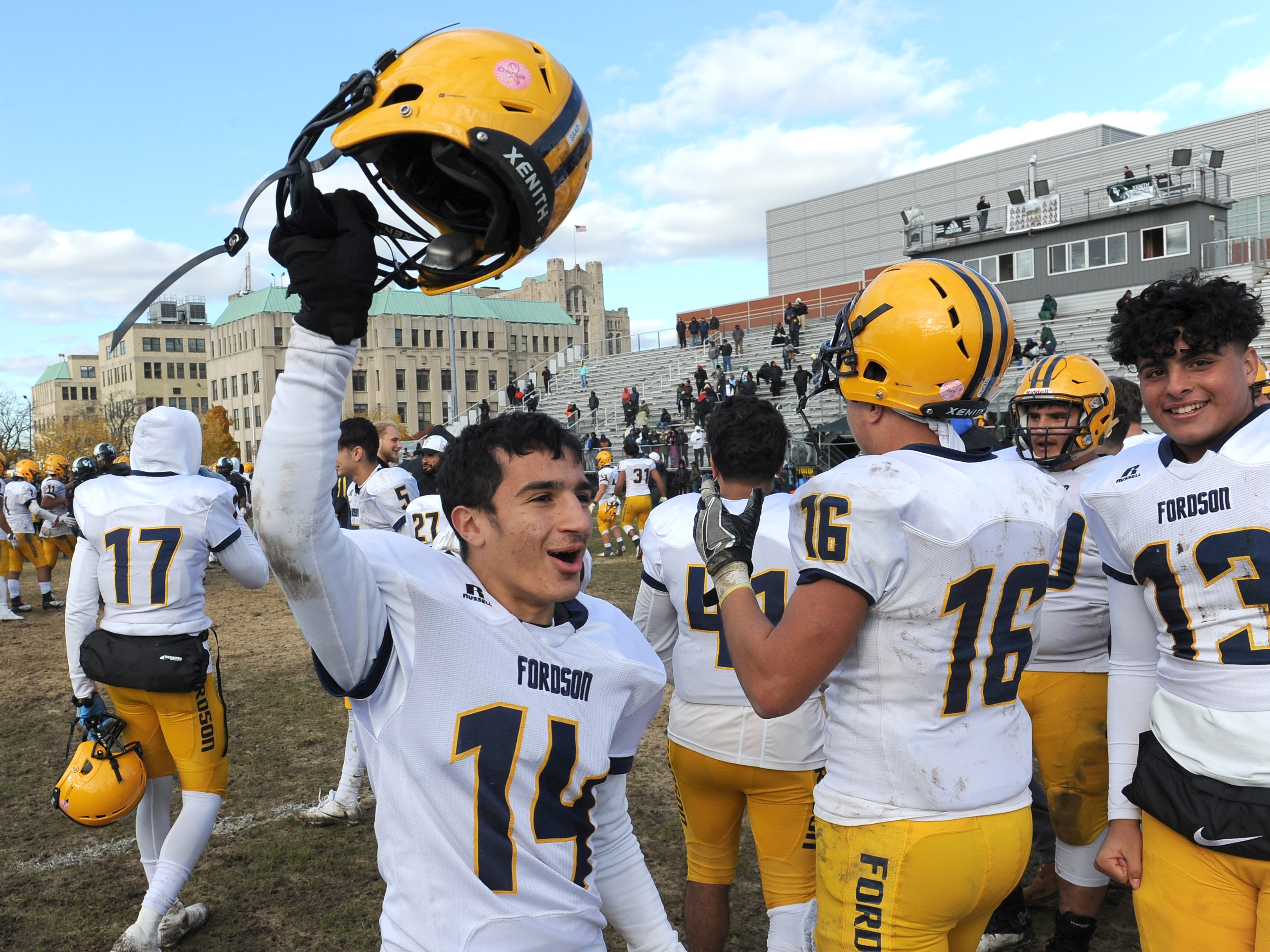 Dearborn Fordson High School's Ali Saad (14) celebrates the win over Cass Technical High School 41-14 on Saturday November 3, 2018.