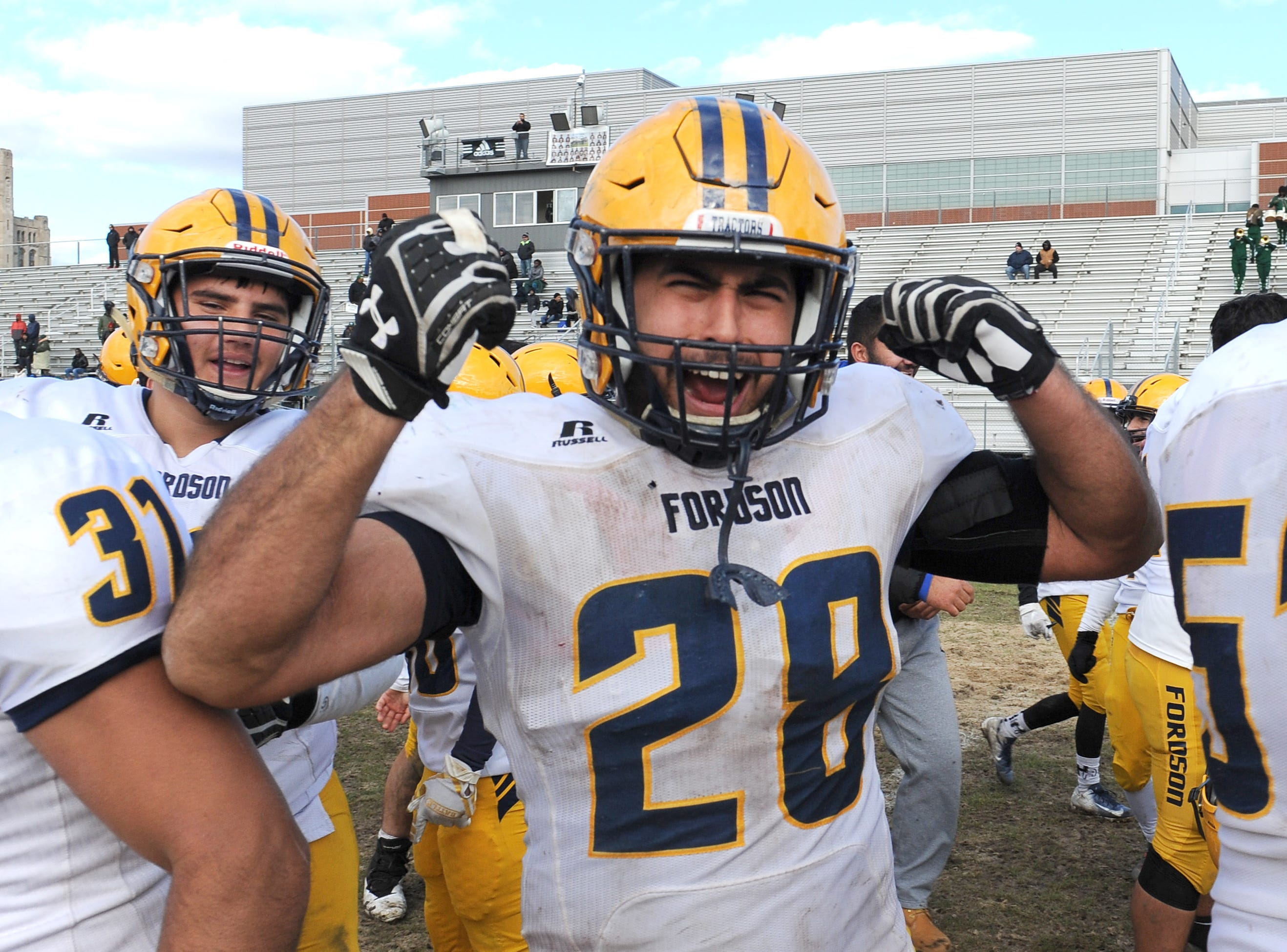 Dearborn Fordson High School's Samer Ajami (28) celebrates the win over Cass Technical High School 41-14 on Saturday November 3, 2018.