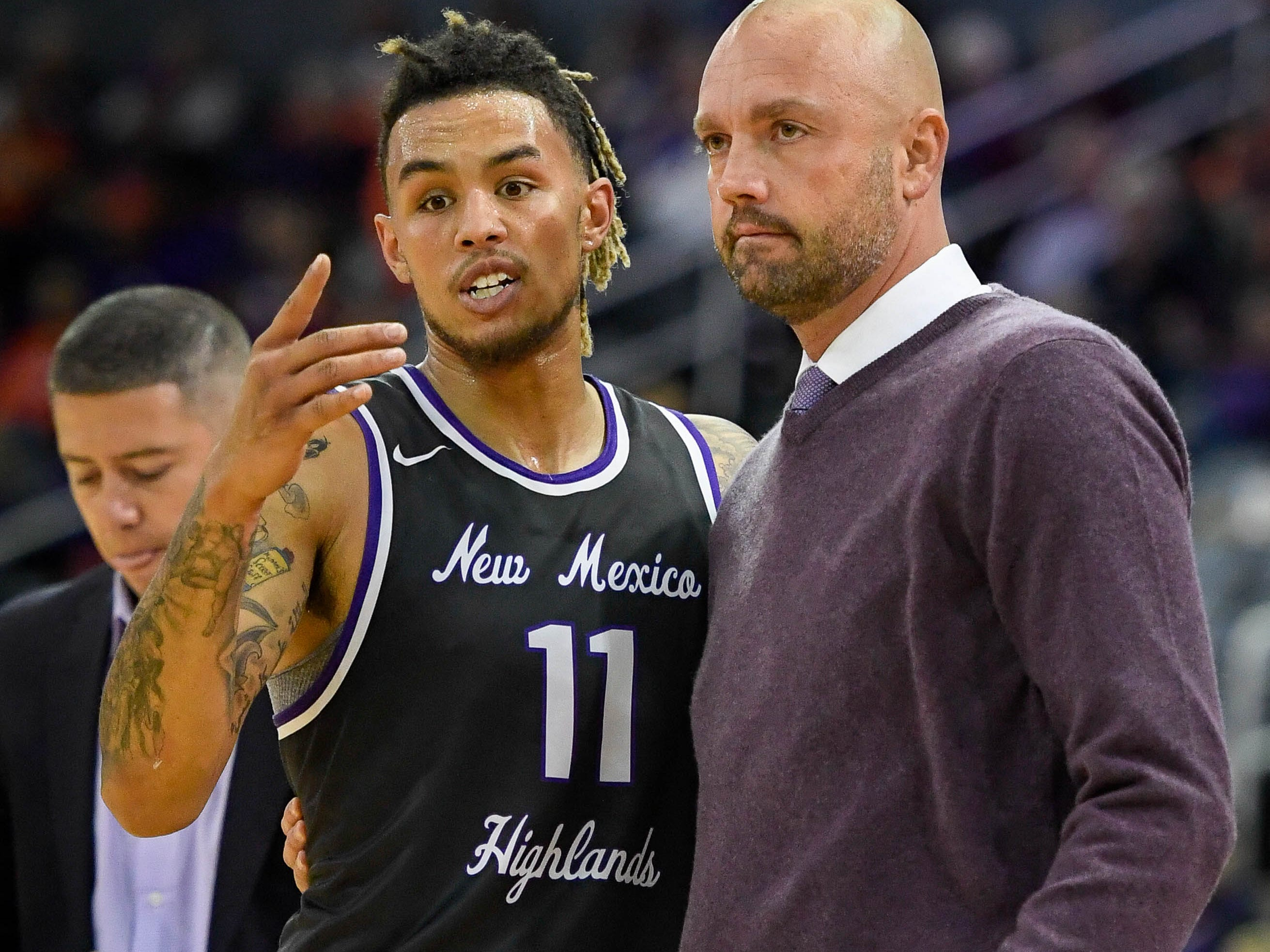 New Mexico Highlands' Jordan Jones (11) talks with New Mexico Highlands head coach Craig Snow as the University of Evansville Purple Aces play the New Mexico Highlands Cowboys in a exhibition game at the Ford Center Saturday, November 3, 2018.