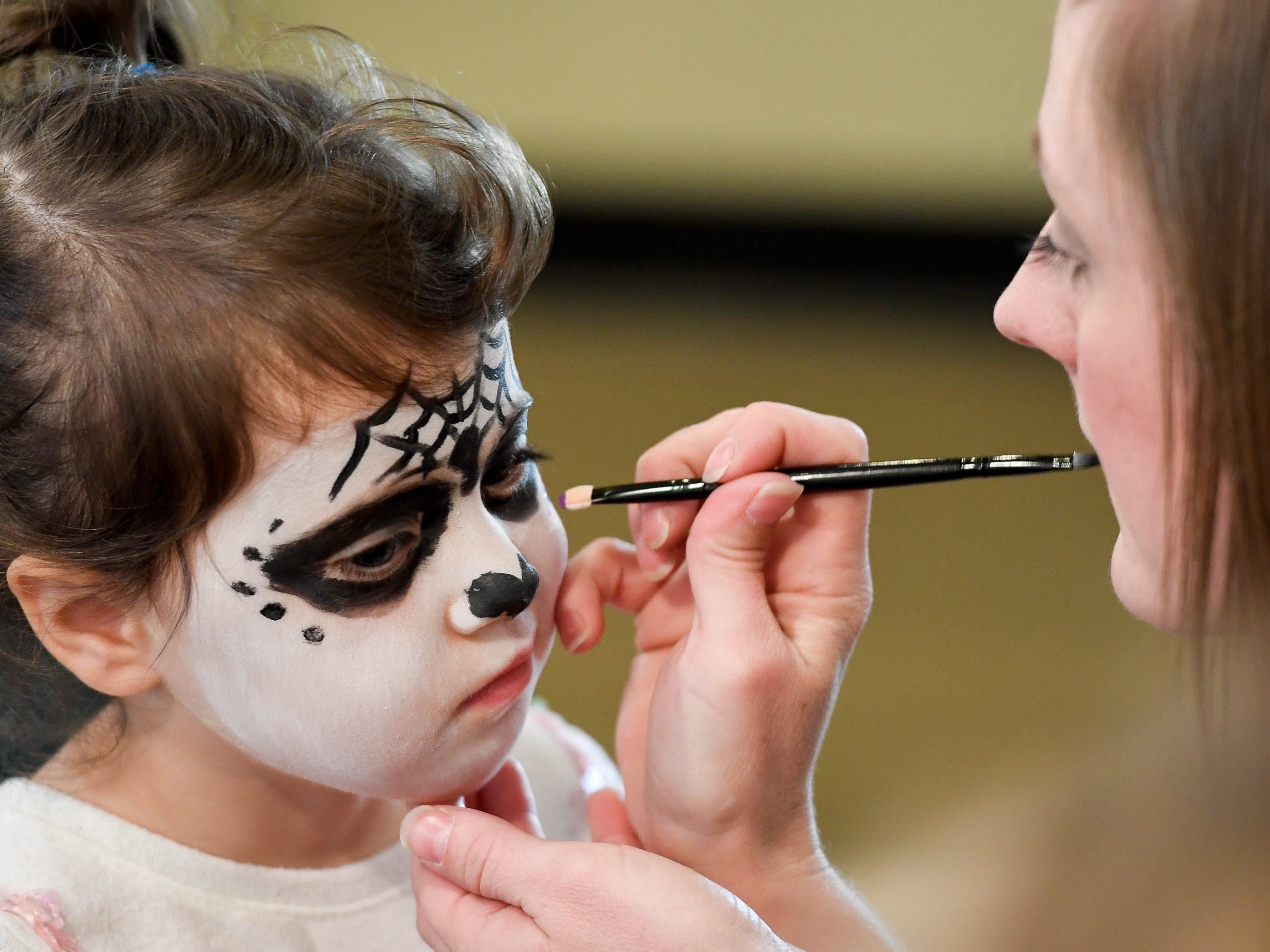 Carter Claire Wilkerson, three years-old, gets her face painted by Kerry Sensenbrenner at the Day of the Dead held at Evansville's Angel Mounds State Historic Site Saturday, November 3, 2108.
