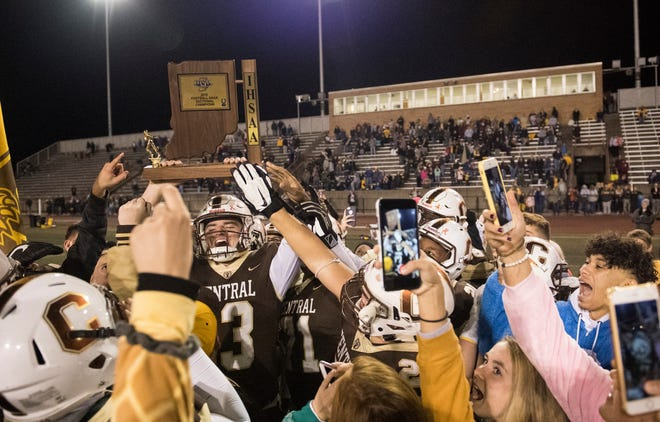 The Central Bears football team celebrates their Class 4A Sectional 24 championship victory against the Boonville Pioneers at Central Stadium Friday, Nov. 2, 2018.