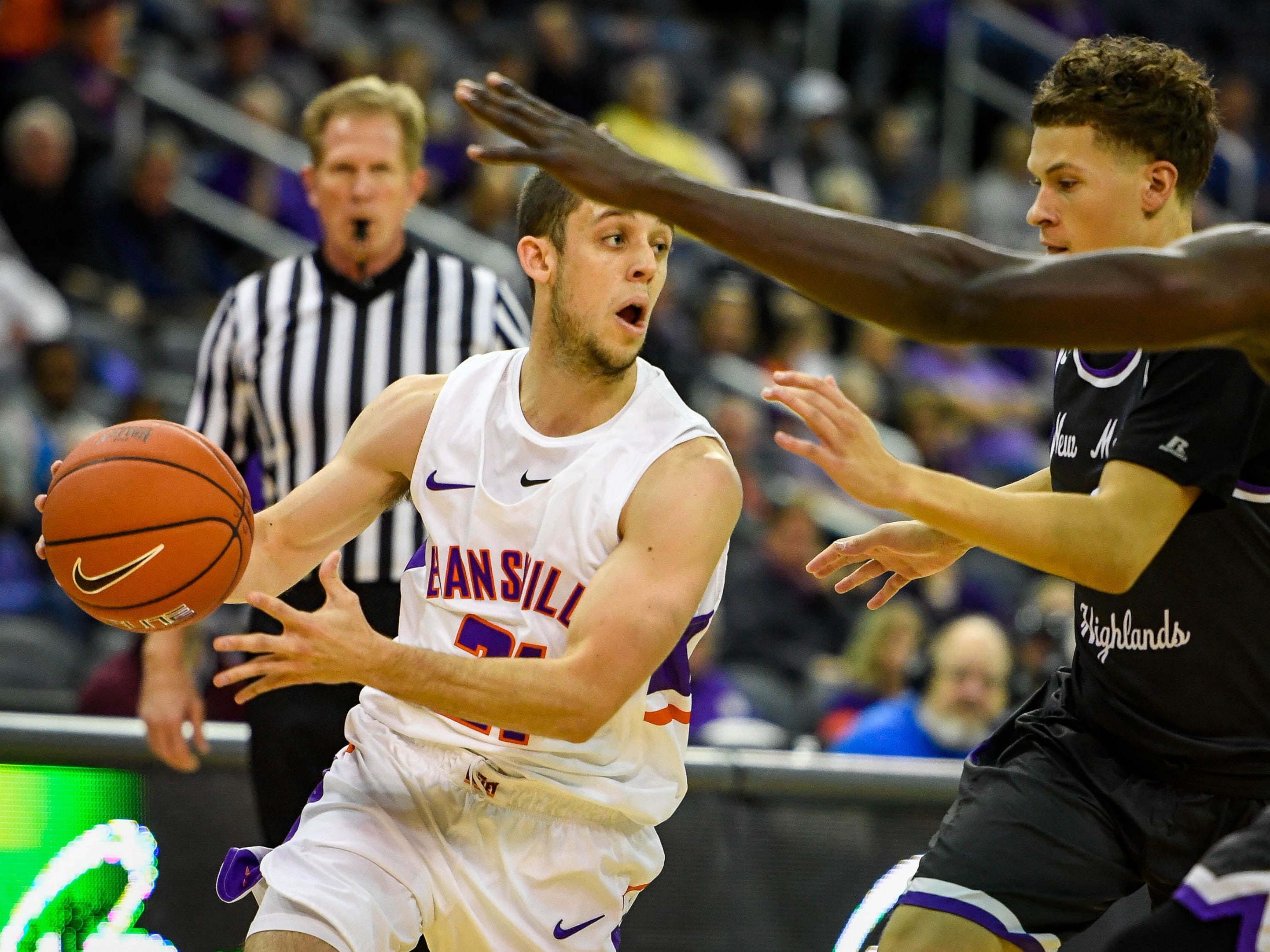 University of Evansville's Shea Feehan (21) look to pass as the University of Evansville Purple Aces play the New Mexico Highlands Cowboys in a exhibition game at the Ford Center Saturday, November 3, 2018.