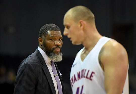 University of Evansville head coach Walter McCarty watches as University of Evansville's Dainius Chatkevicius (14) heads toward the bench as the University of Evansville Purple Aces play the New Mexico Highlands Cowboys in a exhibition game at the Ford Center Saturday, November 3, 2018.