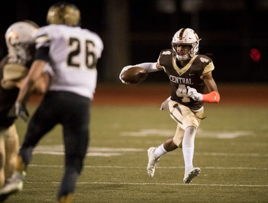 Central's Malcolm Depriest (4) carries the ball during the Class 4A Sectional 24 championship game against the Boonville Pioneers at Central Stadium Friday, Nov. 2, 2018.