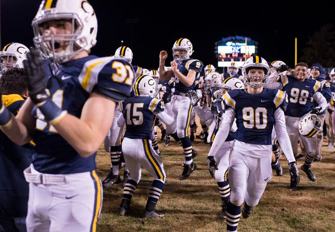 Castle celebrates their win at John Lidy Field in Paradise, Ind., Friday night. Castle beat Terre Haute South 55-34 to win the sectional title.