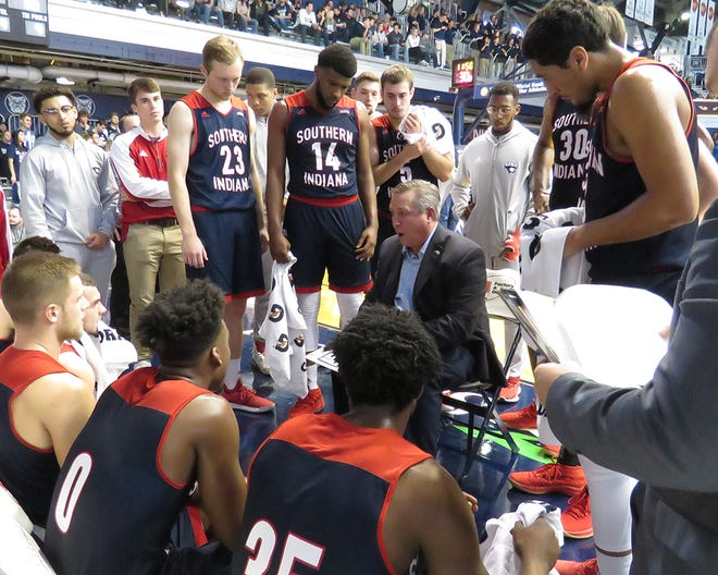 Rodney Watson talks with the Southern Indiana men's basketball team during a timeout Saturday at Butler's Hinkle Fieldhouse.