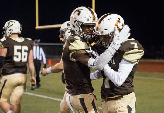Central's Malcolm Depriest (4) congratulates Central's Jalen Bowman (7) after Bowman scores a touchdown during the Class 4A Sectional 24 championship game against the Boonville Pioneers at Central Stadium Friday, Nov. 2, 2018.