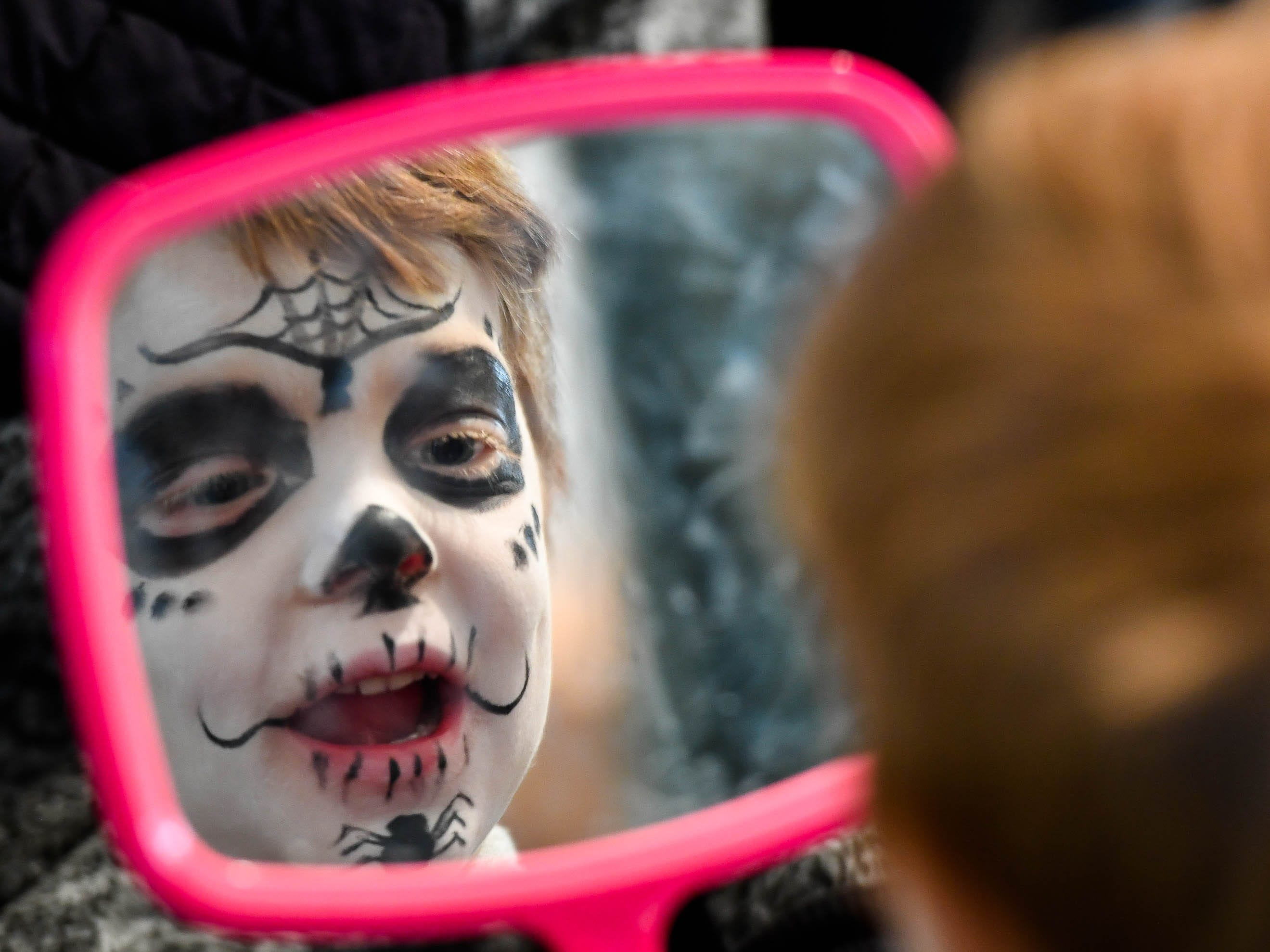 Cletus Rexing, three years-old, from Chandler, checks out his freshly painted face at the Day of the Dead held at Evansville's Angel Mounds State Historic Site Saturday, November 3, 2108.