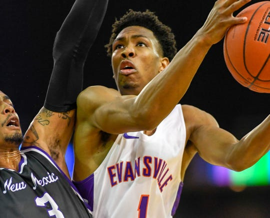 University of Evansville's Marty Hill (1) looks to shoot over New Mexico Highlands' Gerad Davis (3) as the University of Evansville Purple Aces play the New Mexico Highlands Cowboys in a exhibition game at the Ford Center Saturday, November 3, 2018.