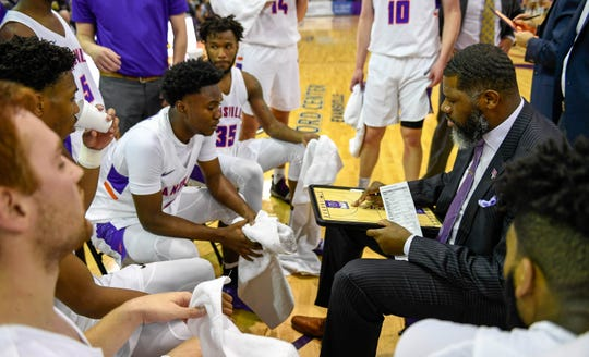 Evansville basketball coach Walter McCarty talks with his team during a timeout in Saturday's exhibition game.