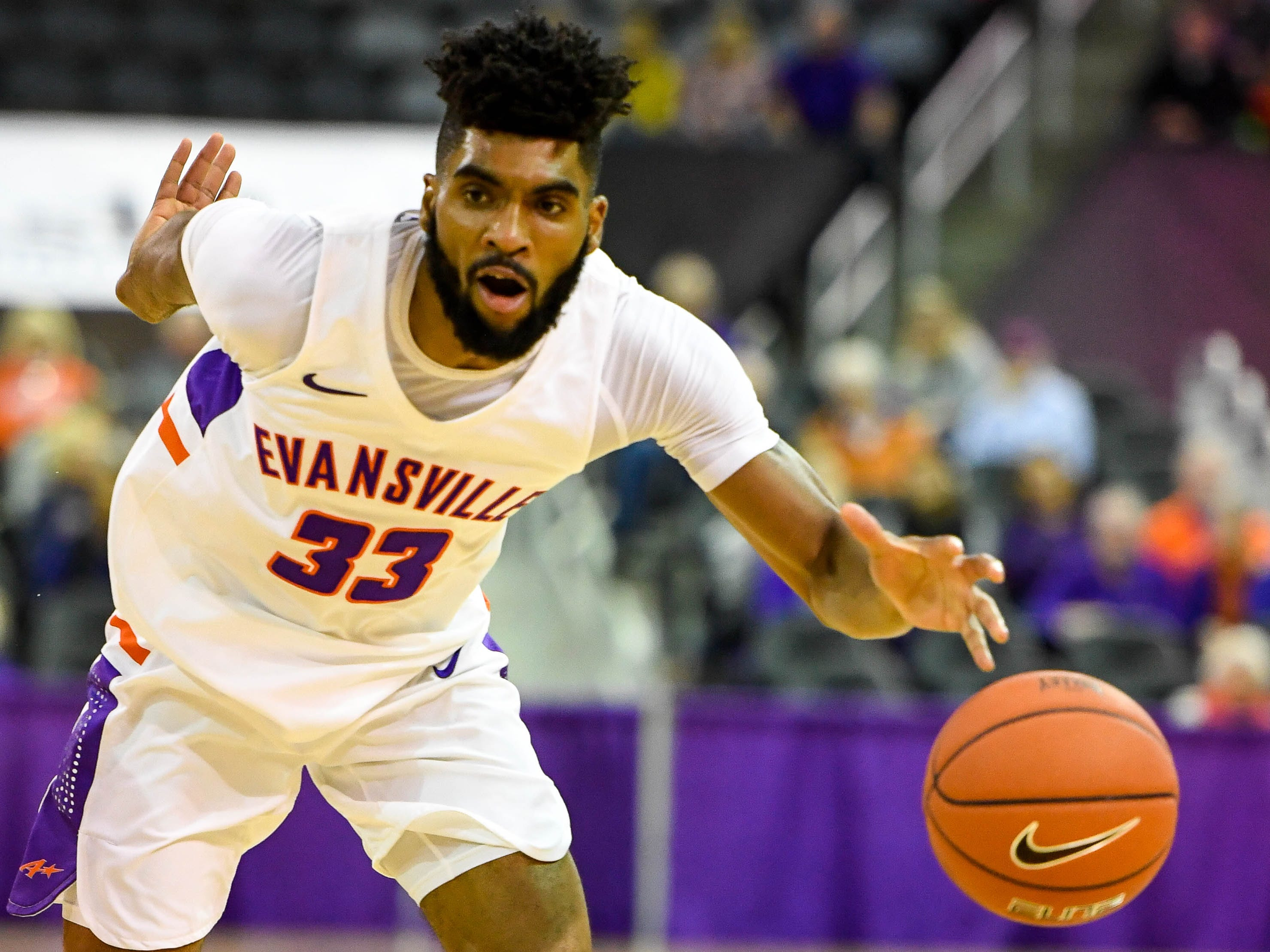 University of Evansville's K.J. Riley (33) pushes the ball as the University of Evansville Purple Aces play the New Mexico Highlands Cowboys in a exhibition game at the Ford Center Saturday, November 3, 2018.