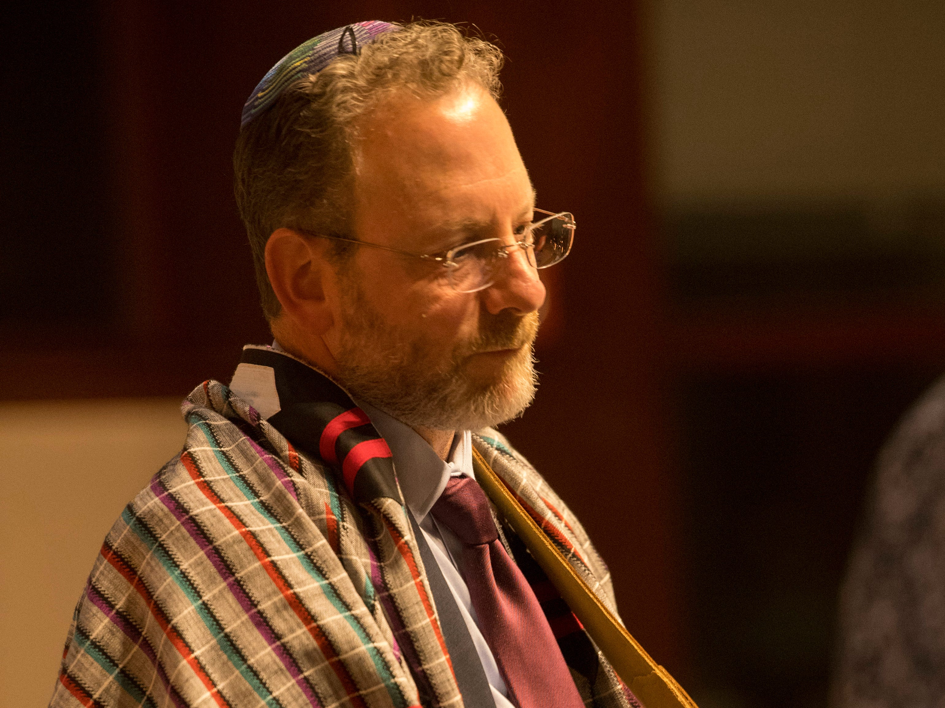 Rabbi Gary Mazo leads the congregation at Temple Adaith B'Nai Israel in Evansville in song at Shabbat services Friday night. The synagogue invited members of the community to join in the service which marks the start of the Jewish sabbath. The killing of 11 worshippers at a Pittsburgh, Penn., synagogue last Saturday was the catalyst for the national #ShowUpForShabbat event.