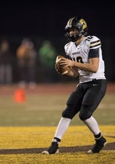 Boonville's Jackson Phillips (10) looks to makes a pass during the Class 4A Sectional 24 championship game against the Central Bears at Central Stadium Friday, Nov. 2, 2018.