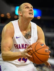 University of Evansville's Dainius Chatkevicius (14) looks to put the ball up as the University of Evansville Purple Aces play the New Mexico Highlands Cowboys in a exhibition game at the Ford Center Saturday, November 3, 2018.