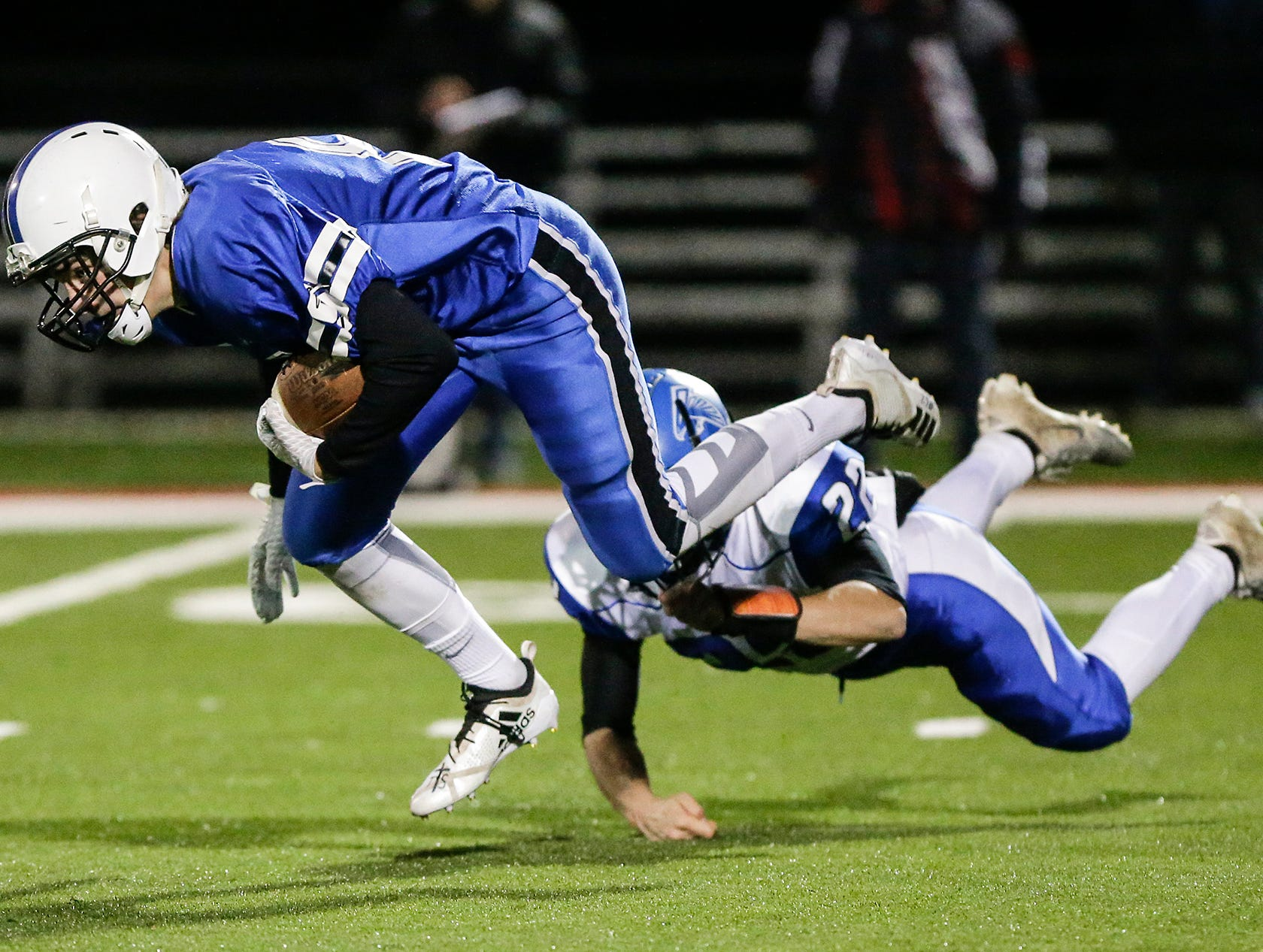St. Mary's Springs Academy football's David Mueller gets tripped up by Amherst High School's Isaac Premus Friday, November 2, 2018 during their WIAA division 5 level 3 playoff game played in Lomira, Wisconsin. Springs won the game 12-0. Doug Raflik/USA TODAY NETWORK-Wisconsin
